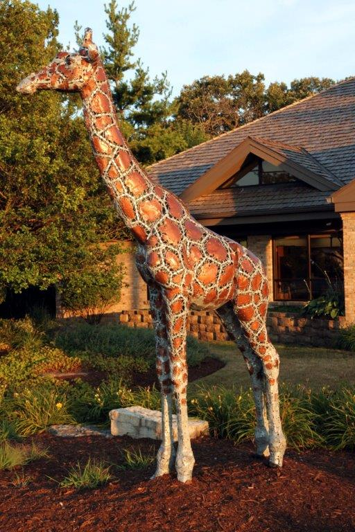 Giraffe Statue and Mascot Outside our Joliet Dental Office