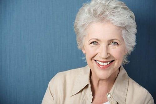 older woman wearing cost effective modern dentures