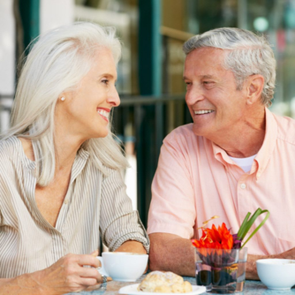 Fixing Dentures for an Older Couple Drinking Coffee