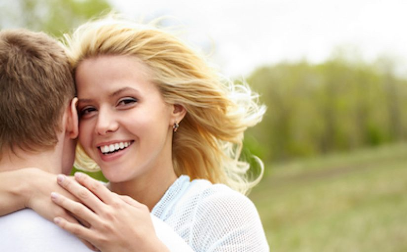 Close-up Picture of a Caucasian Women with Blonde Hair and Brown Eyes in a White Shirt, Smiling